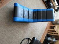 BLACK AND BLUE ROCKING GAMER SEAT.