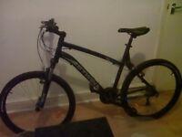 Black and blue btwin mens bike