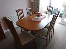 Teak oval extending table and 6 chairs