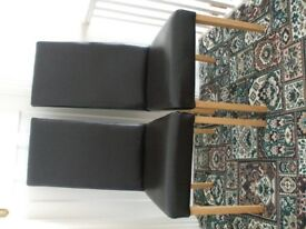 2 dark brown chairs and 1 antique chair