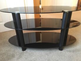 TV STAND 3-tier long oval black glass. Excellent condition