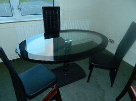 Ex display glass oval table with 3 chairs