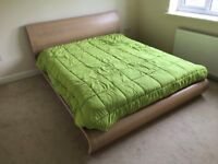 Double wooden bed with mattress