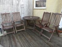 Outside wooden table and 4 chairs with sun umbrella