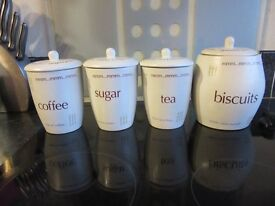 Unused tea, coffee, sugar and biscuits jars