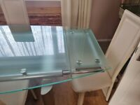 Solid italian glass extenadable dining table and 6 chairs