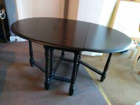 Oval vintage oak gate leg dining table