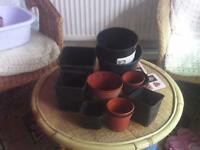 Bag of assorted plastic pots-round and square.Used but in good condition.