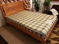 Double, pine bed with very comfortable and good quality mattress.