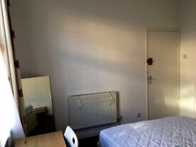 A furnished double bed in a sunny terraced house