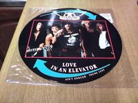 "AEROSMITH LOVE IN AN ELEVATOR 12"" PICTURE DISC IN EXCELLENT CONDITION"