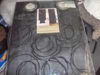 new black embellished lined eyelet curtains 46in wide x54in drop each curtain.