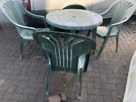 Plastic garden table and chairs £20