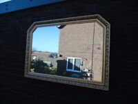 SOLID WOOD LARGE GOLDEN WALL MIRROR VERY SOLID AND HEAVY MIRROR AND IT'S IN EXCELLENT CONDITION