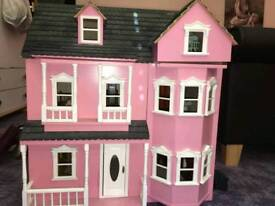 Pink hand made dolls house