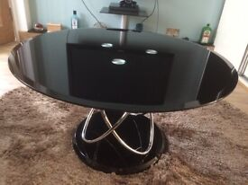 Round black glass and chrome coffee table