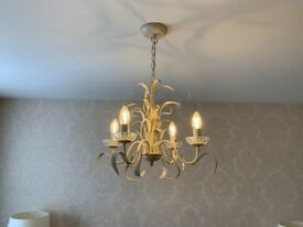 chandelier light and two bedside table lamps