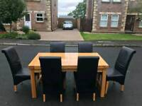 Dining room table and 6 black leather chairs