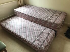 Single Bed with single Bed stored under