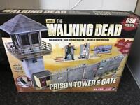The walking dead mcfarlane prison tower and gate model kit