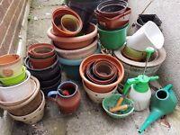 Various plant pots and garden utensils