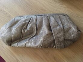 gold clutch bag, used once