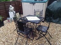 Wrought iron decorative table & 4 chairs, heavy