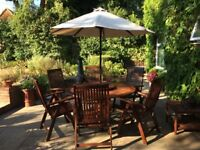 Patio table , six adjustable chairs with cushions and an umbrella,table 5 foot diameter