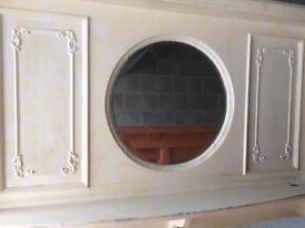 Fire surround original circa 1900 with circular bevelled mirror between mantelsits £400.