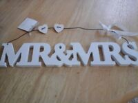 "Wooden ""Mr & Mrs sign. With wire hanger."