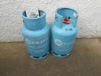 Two empty 12.6K gas bottles one with Regulator, suitable for Barbecues.