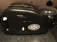 Tefal toast n bean toaster. Also cooks eggs