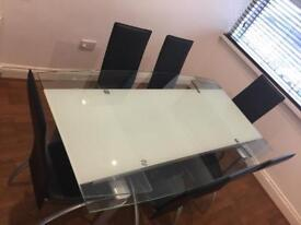 Glass extendable dining table & 6 leather chairs