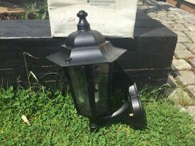 Two outside black aluminium lantern wall lights
