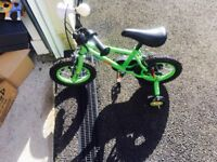 Boys bike with stabilisers and helmet