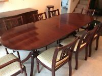 Dark wood dining table, 6 chair and 2 carvers and sideboard. Very good condition.