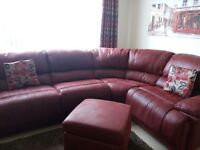 Red soft leather corner sofa with footstool