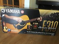 Yamaha F310 accoustic guitar. Barely used. Tuition CD included.