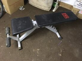 adjustable weight bench and selection of weights and bars