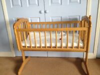 Swinging crib with new mattress