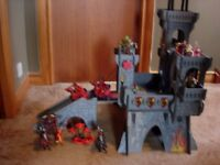 Toy castle with loads of figures , garage with car wash