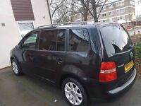 A 2007 VOLKSWAGEN TOURAN SE FSI with manual transmission and a mileage of only 63000!