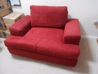 Red fabric cuddle chair, good condition, can seat two people.
