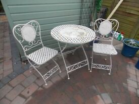 Small metal folding garden table and chairs.