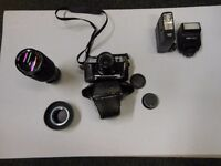 Canon camera E-1 complete with vivitar series 1 70-210mm 1:3:5 lens