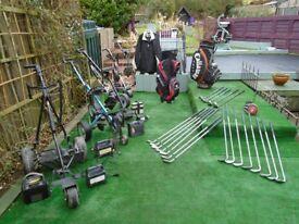 various golf equipment including clubs, trollies inc batteries, chargers, waterproof suit , scooper