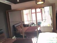Modern brown wooden effect wardrobe, 3 glass mirror doors, superb condition.