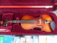 Loreato 4/4 violin with case and music.