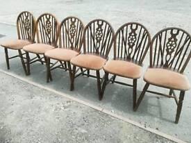 6x wheelback, upholstered chairs.