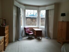 Double room available in Buddhist Centre in West End - great location looking on to Kelvingrove Park